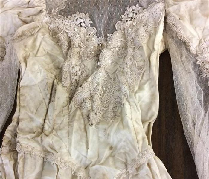 Esporta Wash System Restores Wedding Dress Before